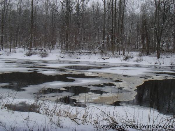 """The road crew's scattered sand mixed with nature's ice and snow."""""""