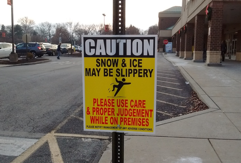 snow and ice warning sign